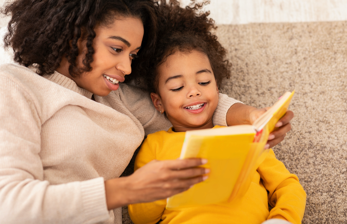 Woman reads to her female child