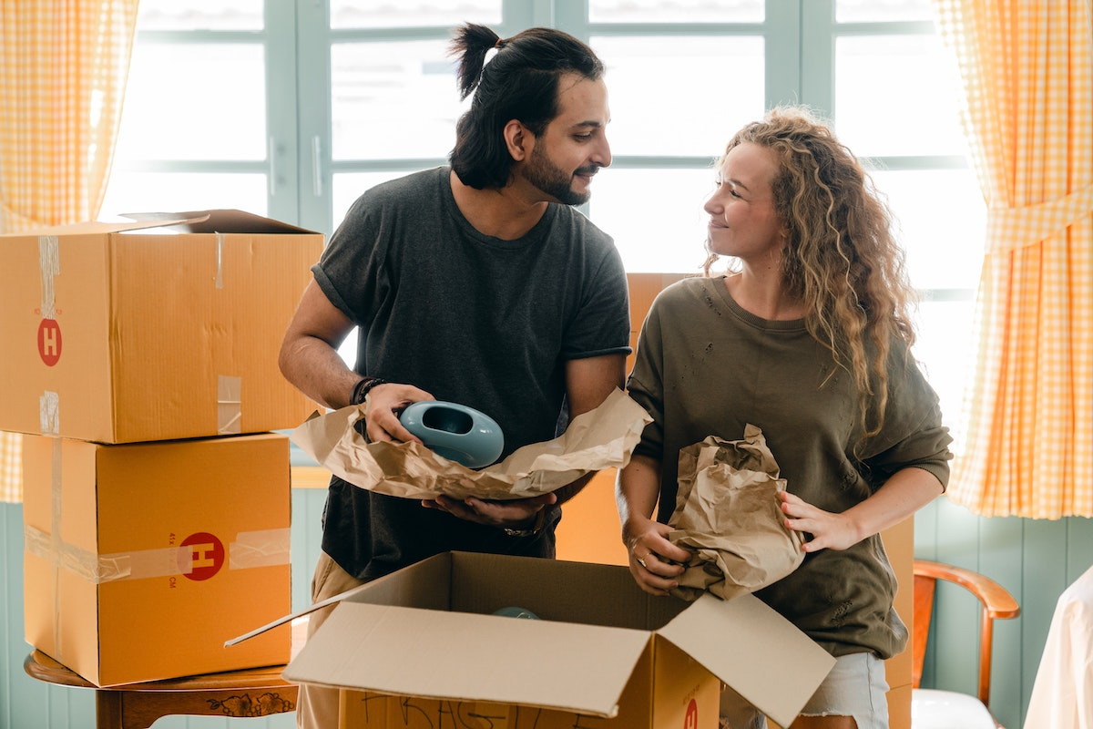 Couple unpacks in new home after moving for financial freedom